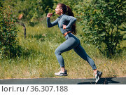 Running girl in city park. Young positive woman runner outdoor jogging... Стоковое фото, фотограф Zoonar.com/Max / easy Fotostock / Фотобанк Лори