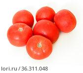 Red ripe tomatoes on light background. Стоковое фото, фотограф Валерия Попова / Фотобанк Лори