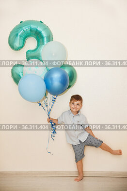 Boy with the number three and the ballons for his birthday