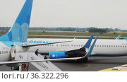 Plane of Pobeda Airlines at the airport. Редакционное видео, видеограф Игорь Жоров / Фотобанк Лори