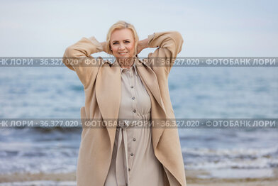 Aged woman walking on the beach