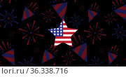 Image of star coloured with american flag on black background. Стоковое фото, агентство Wavebreak Media / Фотобанк Лори