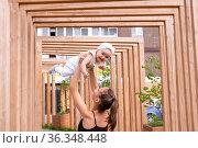 Happy mom with baby daughter play in the city courtyard. Стоковое фото, фотограф Евгений Харитонов / Фотобанк Лори