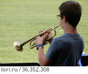 Middle School Boy Playing Trumpet Outdoors, Wellsville, New York, USA. Редакционное фото, фотограф Barrie Fanton / age Fotostock / Фотобанк Лори