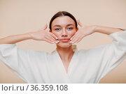 Young woman doing face building facial gymnastics self massage and... Стоковое фото, фотограф Zoonar.com/Max / easy Fotostock / Фотобанк Лори