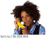 Junge Afroamerikanerin mit Banane - freigestellt auf weissem Hintergrund... Стоковое фото, фотограф Zoonar.com/Birgit Reitz-Hofmann / easy Fotostock / Фотобанк Лори