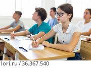 Teenager students sitting at desks. Стоковое фото, фотограф Яков Филимонов / Фотобанк Лори
