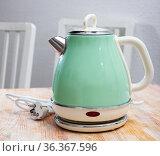 Modern electric kettle on wooden table in kitchen. Стоковое фото, фотограф Яков Филимонов / Фотобанк Лори