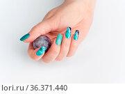 Closeup of woman nails with creative purple and green manicure. Fluorinit... Стоковое фото, фотограф Zoonar.com/Svetlana Mandrikova (SVETOGRAPHY / easy Fotostock / Фотобанк Лори