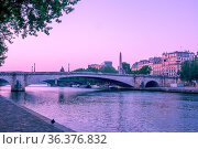 France. Early morning in summer Paris. Seine River embankment and... Стоковое фото, фотограф Zoonar.com/Mikhail Pavlov / easy Fotostock / Фотобанк Лори