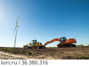 A wind turbines and other heavy machinery used for the assembly of... Стоковое фото, фотограф Marquicio Pagola / age Fotostock / Фотобанк Лори