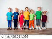 Lovely boys and girls in colorful sportswear posing in front of wall... Стоковое фото, фотограф Zoonar.com/OKSANA SHUFRYCH / easy Fotostock / Фотобанк Лори