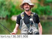 Friendly fisherman smiling, posing and looking at camera. Стоковое фото, фотограф Zoonar.com/DAVID HERRAEZ CALZADA / easy Fotostock / Фотобанк Лори