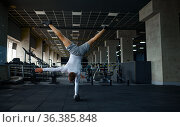 Strong man doing exercise, fitness training in gym. Стоковое фото, фотограф Tryapitsyn Sergiy / Фотобанк Лори