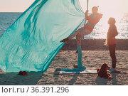 Aerial yoga on the beach. Healthy Woman. Стоковое фото, фотограф Zoonar.com/Max / easy Fotostock / Фотобанк Лори