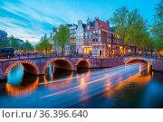 Bridge over Keizersgracht - Emperor's canal in Amsterdam, The Netherlands... Стоковое фото, фотограф Zoonar.com/Yuri Dmitrienko / easy Fotostock / Фотобанк Лори