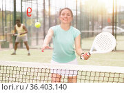 Two sports couples playing padel on tennis court. Стоковое фото, фотограф Яков Филимонов / Фотобанк Лори