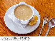 Traditional turkish chicken broth soup on wooden table top view. Стоковое фото, фотограф Яков Филимонов / Фотобанк Лори