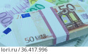 Image of numbers changing and bubbles over stacks of euro currency bills. Стоковое фото, агентство Wavebreak Media / Фотобанк Лори
