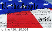 Written constitution of the United States and a flag 4k. Стоковое фото, агентство Wavebreak Media / Фотобанк Лори