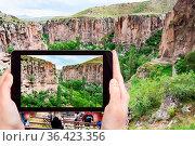 Travel concept - tourist photographs of natural gorge of Ihlara river... Стоковое фото, фотограф Zoonar.com/Valery Voennyy / easy Fotostock / Фотобанк Лори