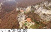 Aerial view of Katskhi pillar, man's monastery near Chiatura, Imereti, Georgia. Стоковое видео, видеограф Яков Филимонов / Фотобанк Лори
