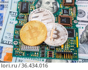Digital cryptocurrency bitcoin, electronic computer component and... Стоковое фото, фотограф Zoonar.com/Alexander Blinov / easy Fotostock / Фотобанк Лори
