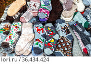 Warm winter wool knitted socks of different sizes and colors. Handmade... Стоковое фото, фотограф Zoonar.com/Alexander Blinov / easy Fotostock / Фотобанк Лори