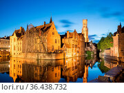 Bruges, Belgium - April 17, 2017: Night shot of historic medieval... Стоковое фото, фотограф Zoonar.com/Yuri Dmitrienko / easy Fotostock / Фотобанк Лори