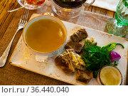 Young bull meat in its own juice with herbs. Khashlama. Стоковое фото, фотограф Яков Филимонов / Фотобанк Лори