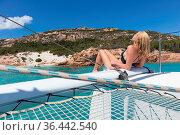 Woman in bikini tanning and relaxing on a summer sailin cruise, sitting... Стоковое фото, фотограф Zoonar.com/Matej Kastelic / easy Fotostock / Фотобанк Лори