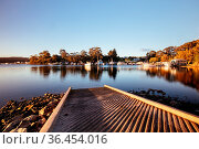 The idyllic setting across Wagonga Inlet at sunset in Narooma, NSW... Стоковое фото, фотограф Zoonar.com/Chris Putnam / easy Fotostock / Фотобанк Лори