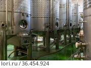 Metallic cisterns for processing and fermentating wine in shop. Стоковое фото, фотограф Яков Филимонов / Фотобанк Лори