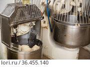 Baker preparing the dough for bread in a dough mixer. Стоковое фото, фотограф Яков Филимонов / Фотобанк Лори