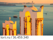 Greece. Sunset on the island of Thira. Bells of the Greek Chapel in... Стоковое фото, фотограф Zoonar.com/Mike Pavlov / easy Fotostock / Фотобанк Лори