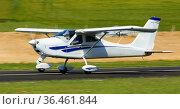 Sports airplane in motion over runway. Стоковое фото, фотограф Яков Филимонов / Фотобанк Лори