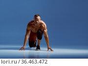 Male athlete preparing for the jerk in studio. Стоковое фото, фотограф Tryapitsyn Sergiy / Фотобанк Лори