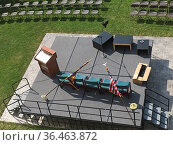 Stage and Chairs Prepped for High School Graduation, Wellsville, ... Стоковое фото, фотограф Barrie Fanton / age Fotostock / Фотобанк Лори