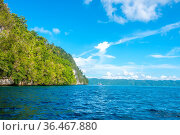 Rocky coast of the tropical island of Indonesia in sunny weather.... Стоковое фото, фотограф Zoonar.com/Mikhail Pavlov / easy Fotostock / Фотобанк Лори