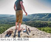 Sportsman having a picnic in the wilderness. Fresh ham toasts and... Стоковое фото, фотограф Zoonar.com/rdonar / easy Fotostock / Фотобанк Лори