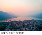 High angle aerial view over Lakeside and Phewa Lake at evening sunset... Стоковое фото, фотограф Zoonar.com/Pius Lee / easy Fotostock / Фотобанк Лори