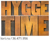 Hygge time - isolated word abstract in vintage letterpress wood type... Стоковое фото, фотограф Zoonar.com/Marek Uliasz / easy Fotostock / Фотобанк Лори