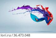 Modern styled dancer jumping over colorful paint splashes. Стоковое фото, фотограф Zoonar.com/Aleksandr Khakimullin / easy Fotostock / Фотобанк Лори