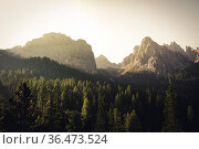 Mountains in morning sunrise light with sun flare in the dolomites... Стоковое фото, фотограф Zoonar.com/Maximilian Pawlikowsky / easy Fotostock / Фотобанк Лори