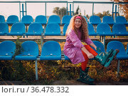 Young curly teenager woman with roller skates outdoor. Стоковое фото, фотограф Zoonar.com/Max / easy Fotostock / Фотобанк Лори