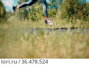 Runner woman in running shoes closeup of woman sporty legs. Female... Стоковое фото, фотограф Zoonar.com/Max / easy Fotostock / Фотобанк Лори