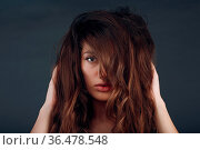 Portrait of beautiful young brunette woman with healthy hair. Стоковое фото, фотограф Zoonar.com/Max / easy Fotostock / Фотобанк Лори