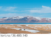 Tibet plateau natural landscape, snow mountains and lake with wasteland... Стоковое фото, фотограф Zoonar.com/zhang zhiwei / easy Fotostock / Фотобанк Лори