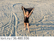 Girl in black nightgown with black fluttering cloth on sandy beach. View from above. Стоковое фото, фотограф Евгений Ткачёв / Фотобанк Лори