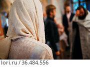 Orthodox Christian priest and parishioner praying in the church. Стоковое фото, фотограф Zoonar.com/Max / easy Fotostock / Фотобанк Лори